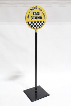 "Sign, Misc, VINTAGE, FREESTANDING, ""PLEASE HONK TO BE SEATED / TAXI STAND"" ON WHITE ROUND SIGN W/HEAVY BLACK METAL POST & SQUARE BASE, BLACK & WHITE CHECKERED SQUARES, IRON, BLACK"